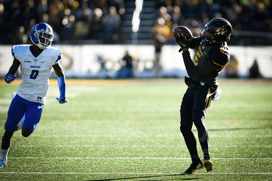 Wide receiver J'Mon Moore receives a 40-yard pass from Drew Lock in the second quarter. Photo by Shane Epping.