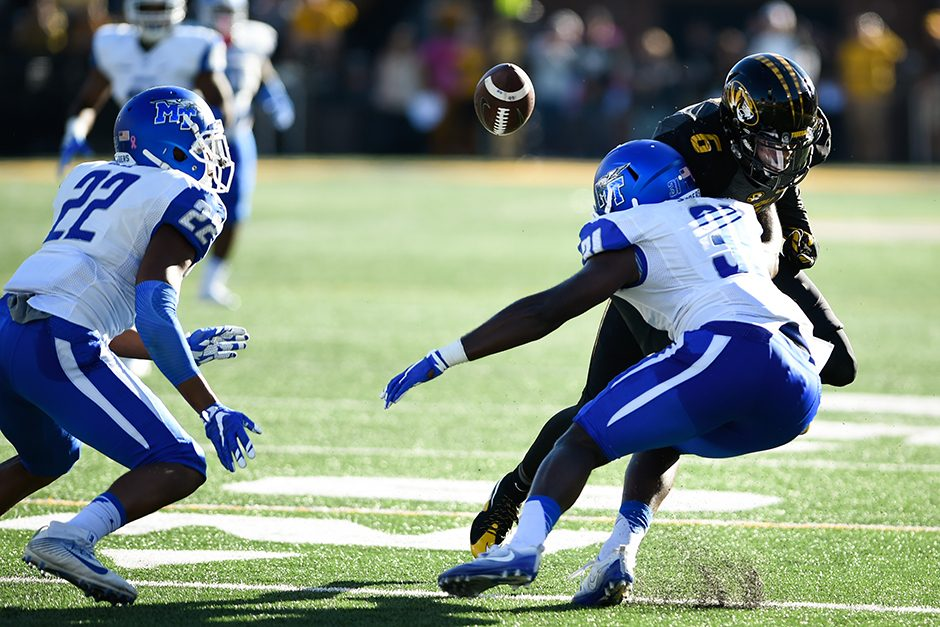 Wide receiver J'Mon Moore fumbles the ball on the 15-yard line, resulting in a Middle Tennessee State touchback. Photo by Shane Epping.