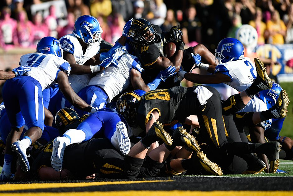 Running back Damarea Crockett rushes for two yards and scores a touchdown to put Mizzou ahead, 28-27. Photo by Shane Epping.