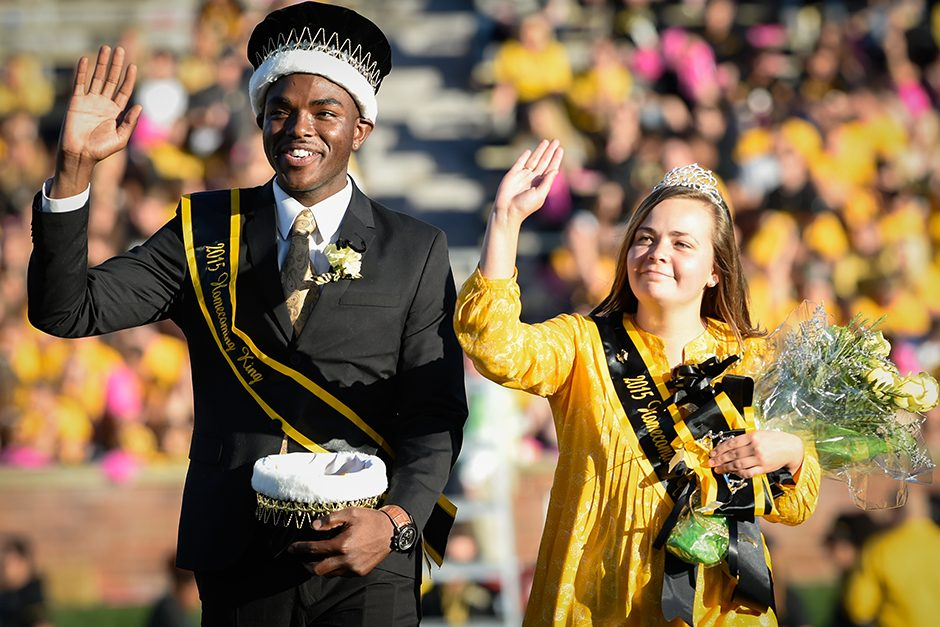 Mizzou's 2015 Homecoming King and Queen, Payton Head and Allison Fitts, wave to the crowd and prepare to crown this year's royalty. Photo by Shane Epping.