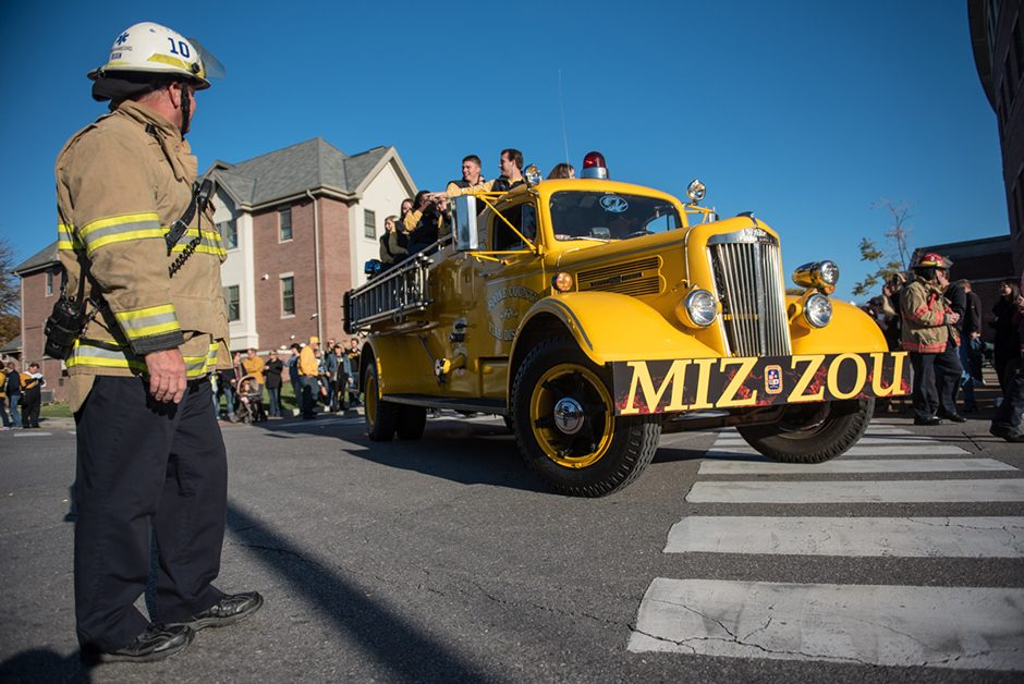 Mizzou Homecoming Steering Committee rode the old yellow fire truck in the parade.