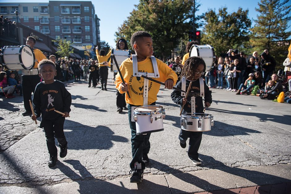 Children playing drums and marching.