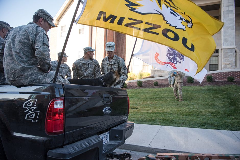 ROTC awaits Homecoming festivities in the back of a pickup truck.