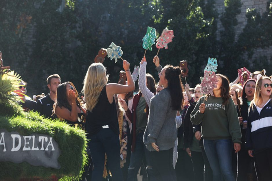 Kappa Delta sorority members cheer at the homecoming parade on Saturday, Oct. 22, 2016.