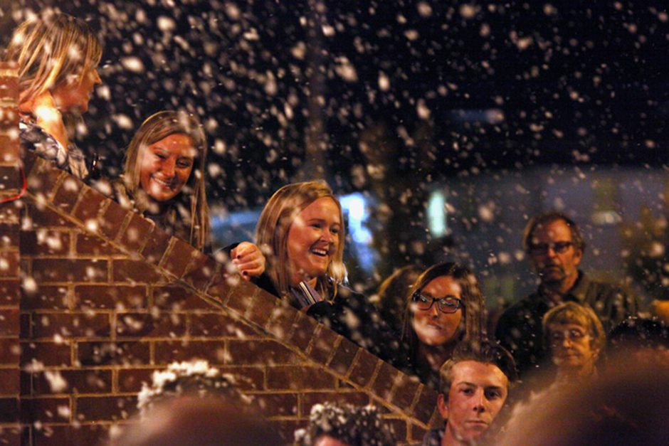Chi Omega sorority member Emily Brown, middle, smiles as fake snow falls upon the crowd gathered to watch the skit put together by Chi Omega and Delta Chi that was based on their theme of The Grinch.