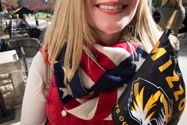 Woman with scarf bearing stars and stripes.