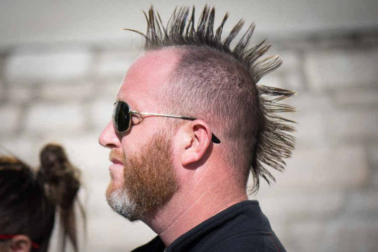Man with mohawk and sunglasses.