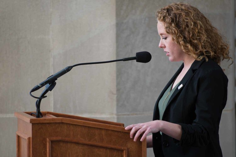 Abigail Eckerly speaking at a lectern.