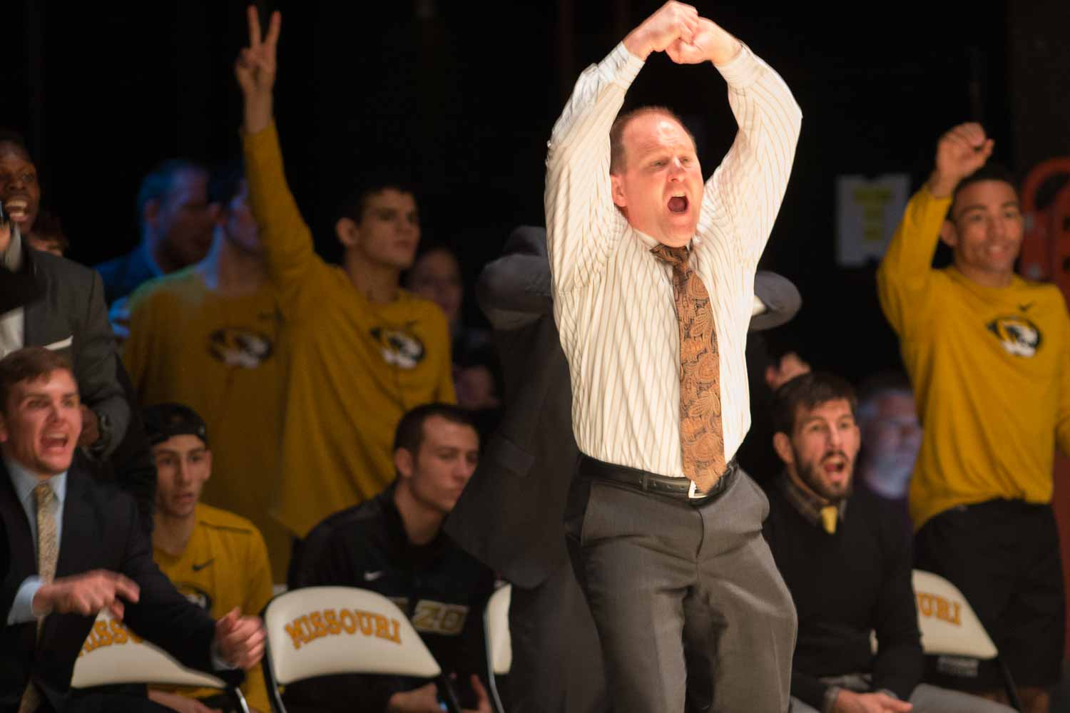 Heach coach Brian Smith signals for a holding call against Virginia Tech's No. 1-ranked Zach Epperly in the 174-pound match against Dylan Wisman.