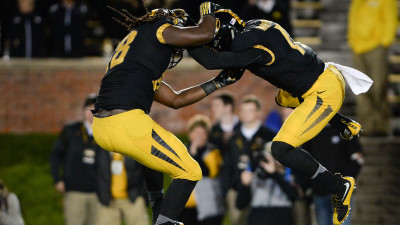 Two football players jumping in the air
