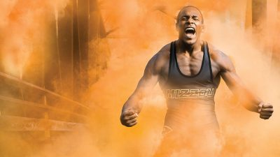 J'den Cox in a cloud of orange smoke.