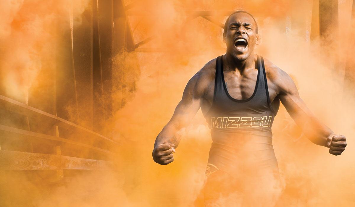 J'den Cox in a cloud of orange smoke.