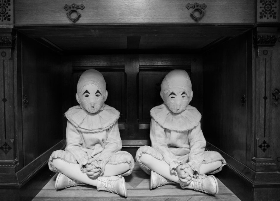 Twin children in white masks.