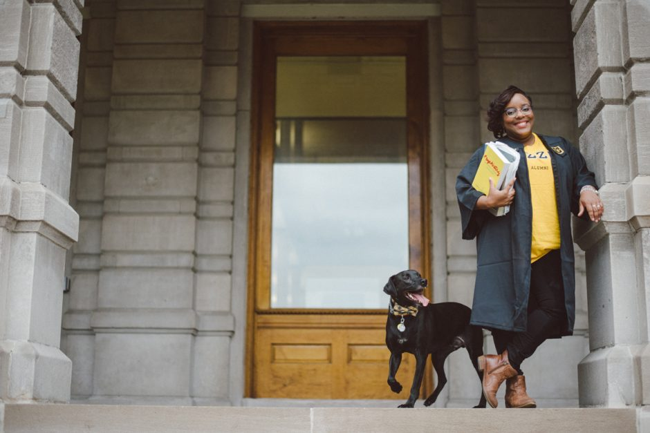 Jada Winchester and her dog on the steps of Jesse Hall