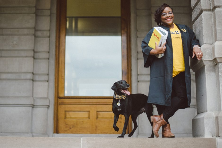 Jada Winchester and her dog in front of Jesse Hall.