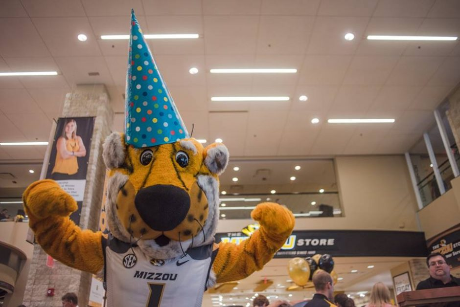 Truman the Tiger mascot in a party hat.