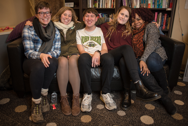 Students sitting on a couch.