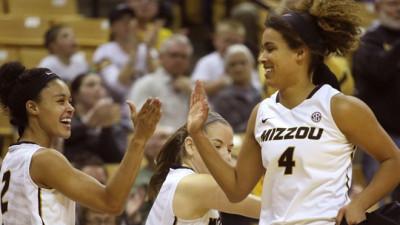 Cierra Porter high-fives a teammate.