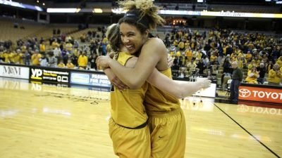 Basketball players hugging