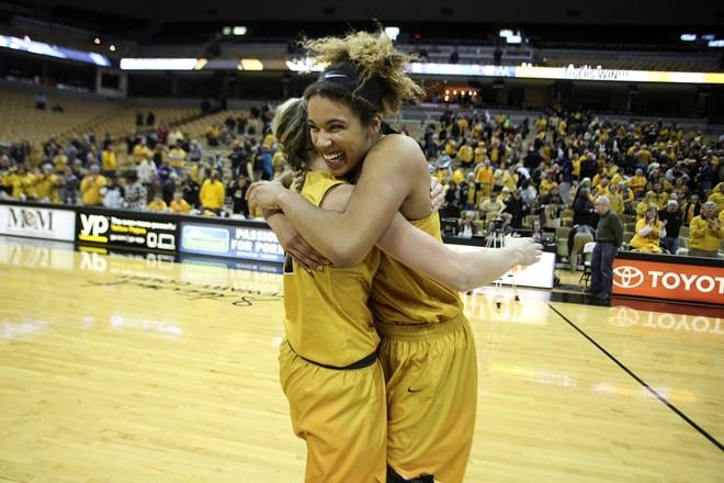 Basketball players hugging