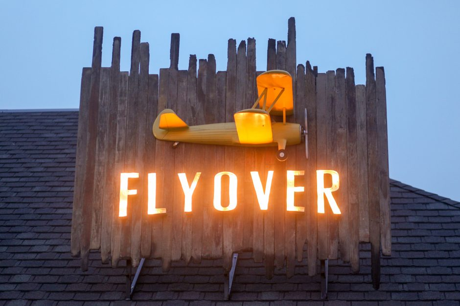 Lighted sign with an airplane that reads