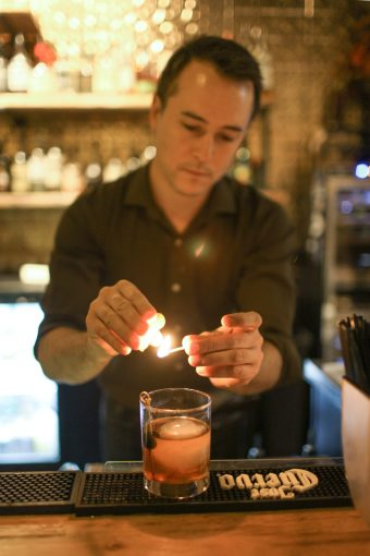 Bartender lighting a candle.