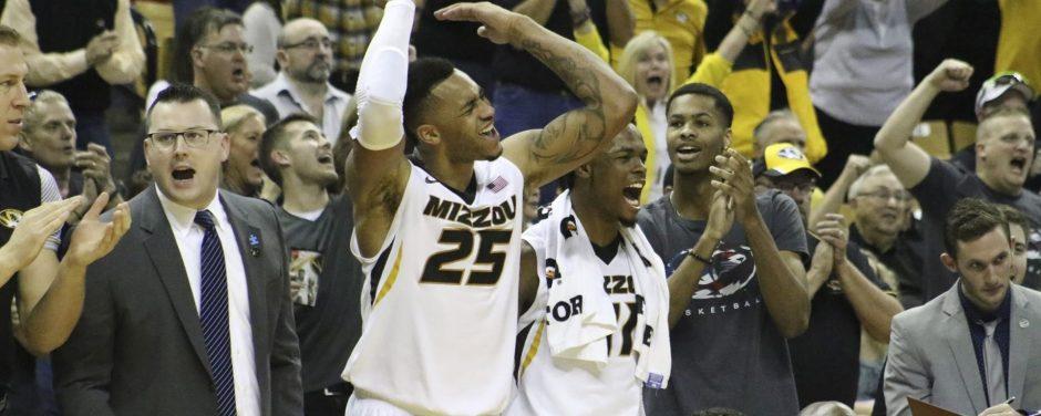Basketball players wallkin across court