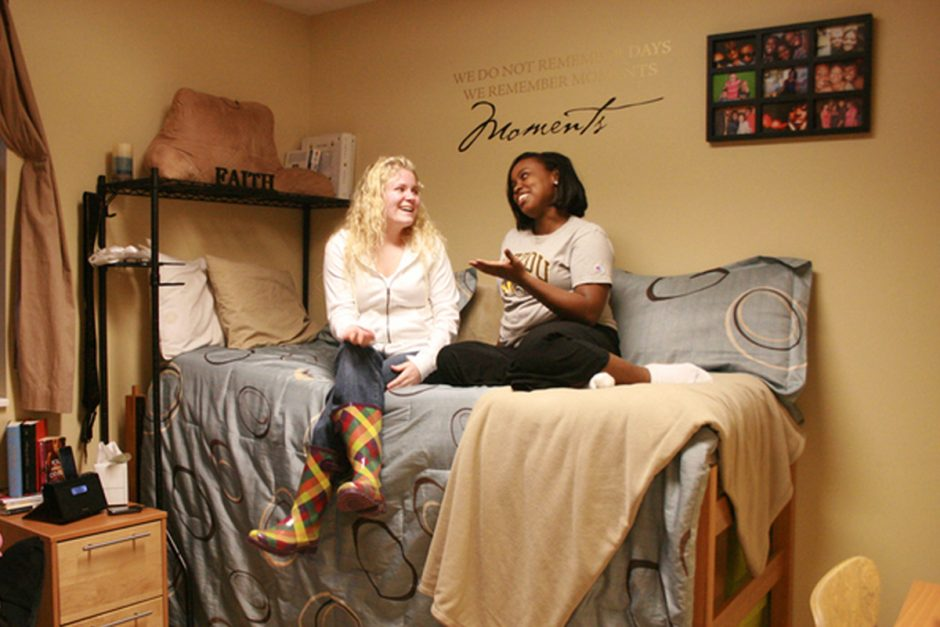 Students sitting on a bed