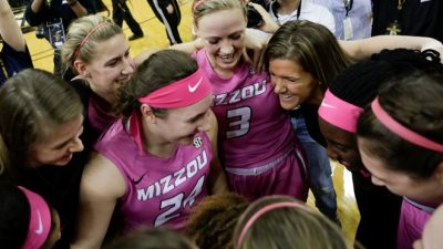 Basketball players huddled together