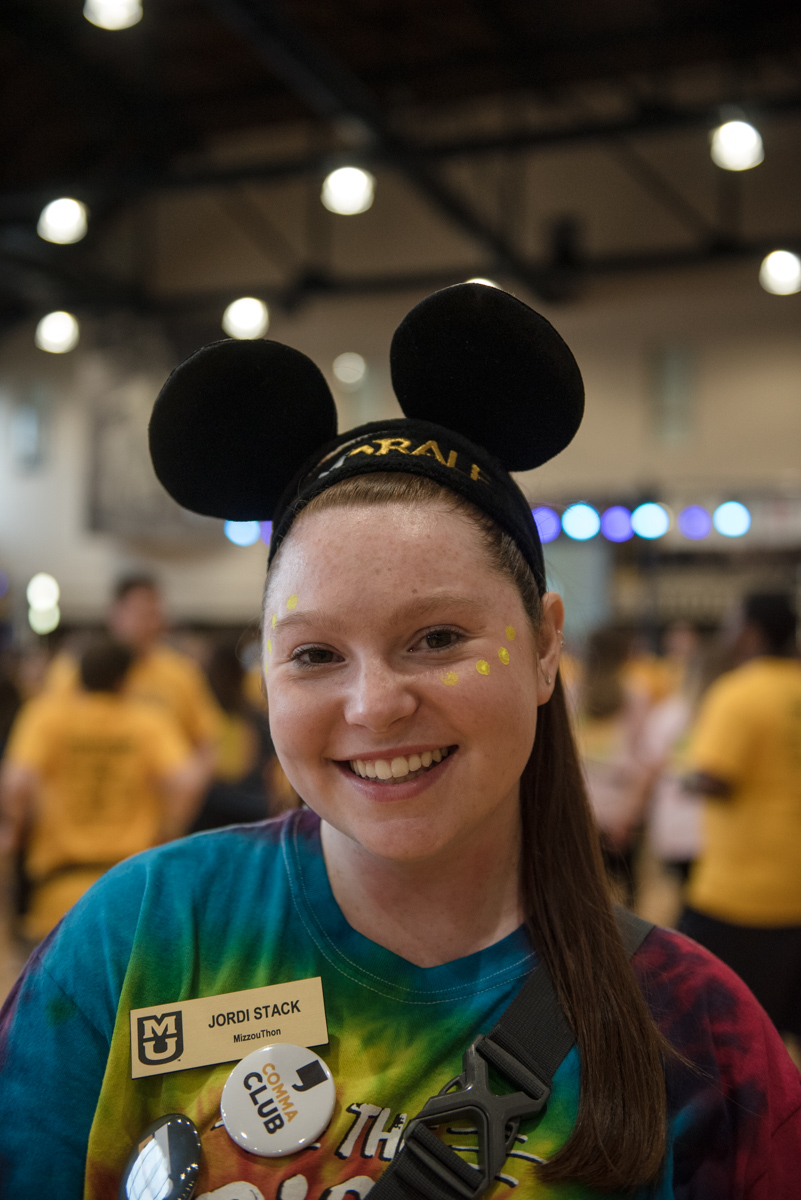 Woman wearing mouse ears with dots painted on her face