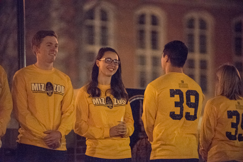 Students in '39' shirts at dusk.