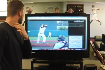 Baseball players on a screen.