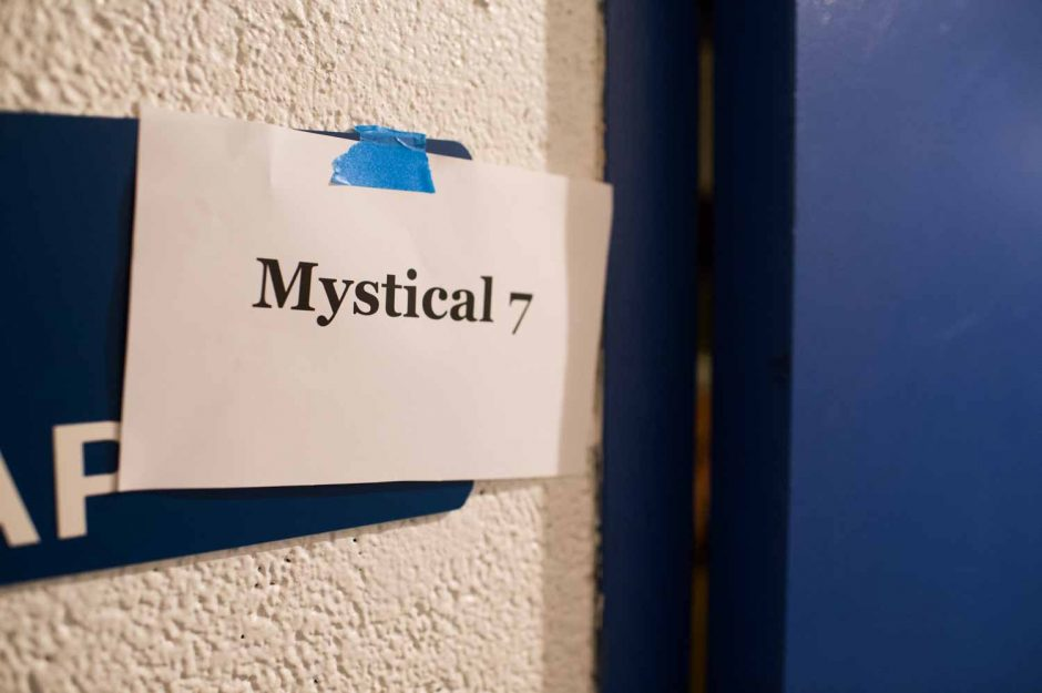 The members of Mystical Seven await their public reveal in the basement of Jesse Hall.