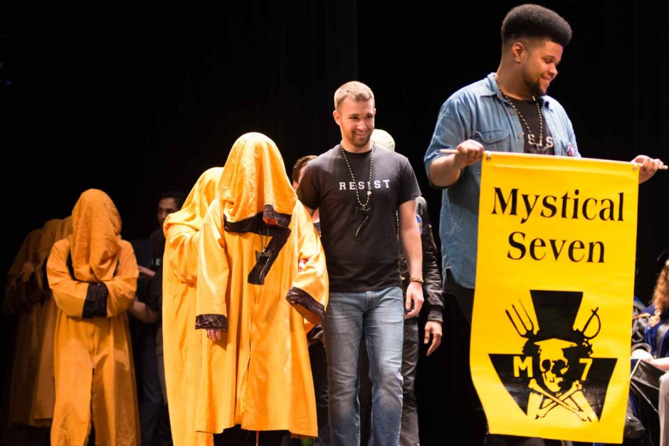 Dariun Wu, right, and Cole Lawson lead new members of Mytical Seven on to the stage.