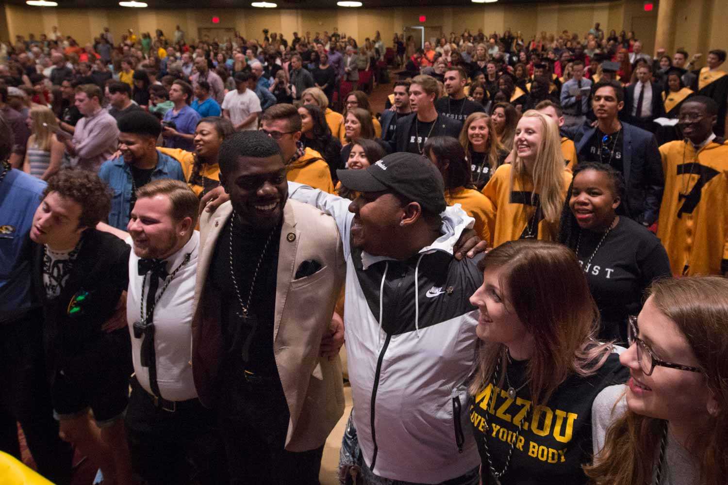 Crowd members embrace one another and sing the alma mater, Old Missouri, after Tap Day comes to an end.