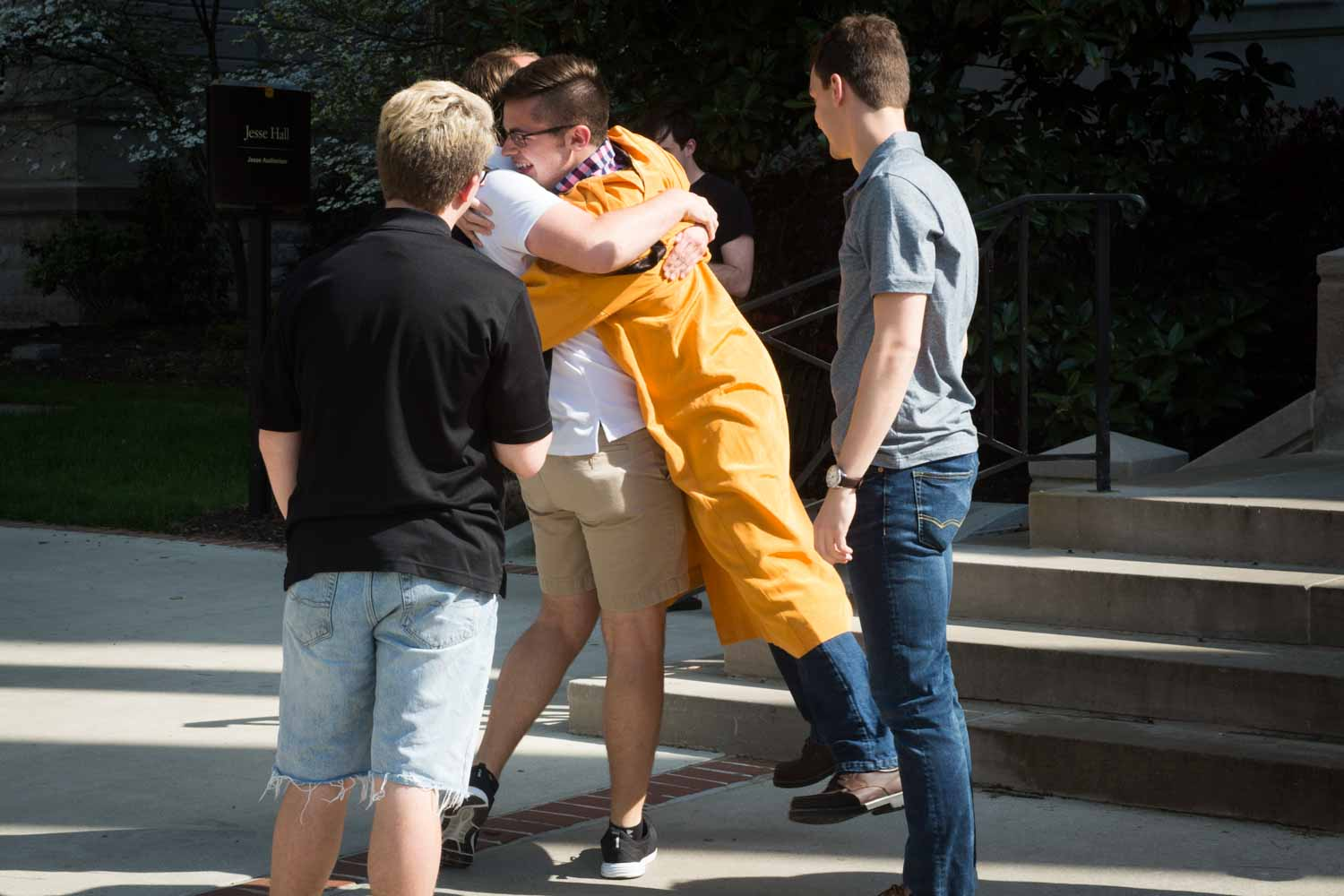 Jake Boeding receives a celebratory hug from a friend after leaving Jesse Hall.