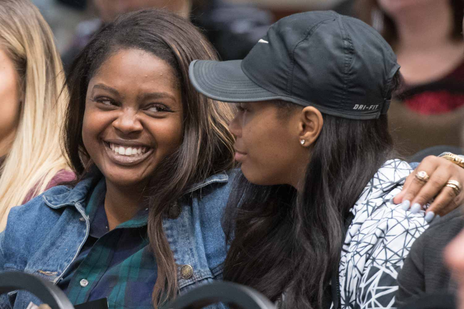 Robbie Hatchett, left, shares a smile with her friend, Raven Smith, who both attended the event in honor of Dariana Byone.