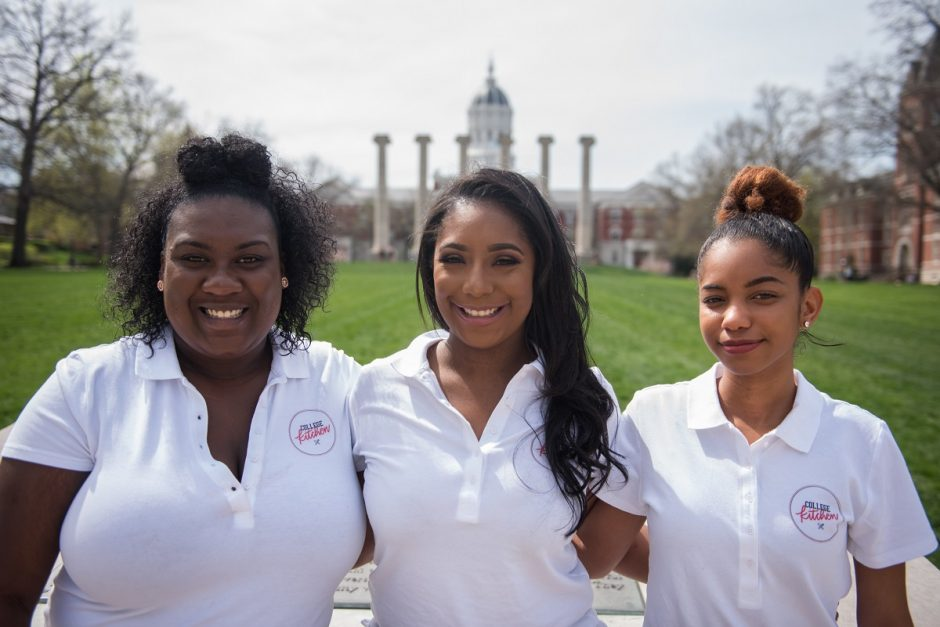 Three students who founded College Kitchen standing in front of the Columns on Francis Quadrangle.