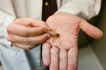 Bacteria vial in researcher's hand.