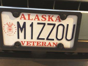 "Alaska license plate that says ""M1ZZOU"""
