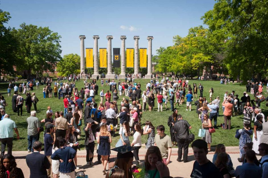 Crowd of people on the Quad on a sunny day.