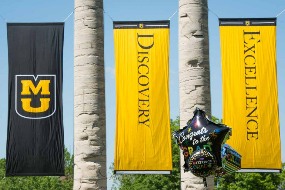 Graduation balloons with Discovery and Excellence banners.