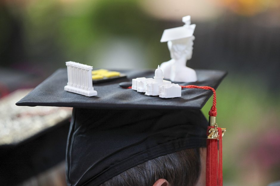 Cap with tiny 3D-printed bust of a graduate, columns and Jesse Hall glued to top.
