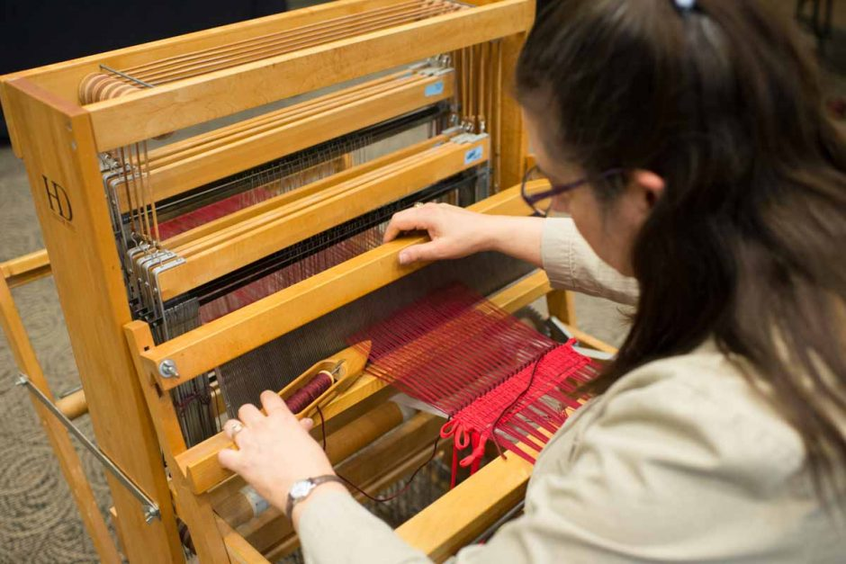 Woman weaving on a loom