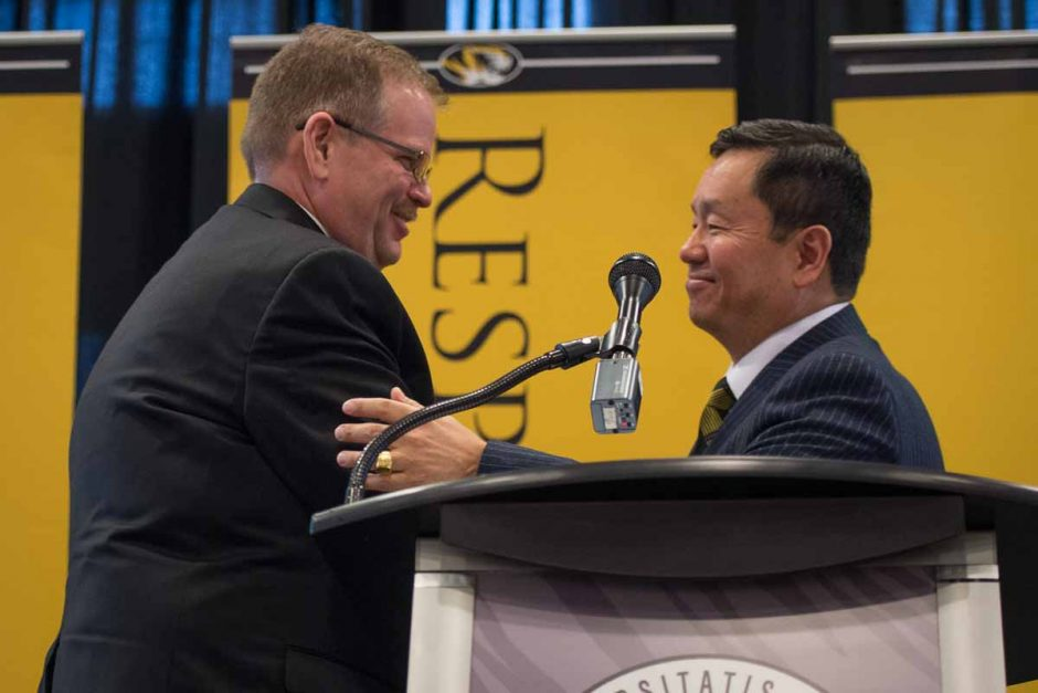 Chancellor Alex Cartwright and President Mun Choi share a handshake when Choi introduces him to speak.