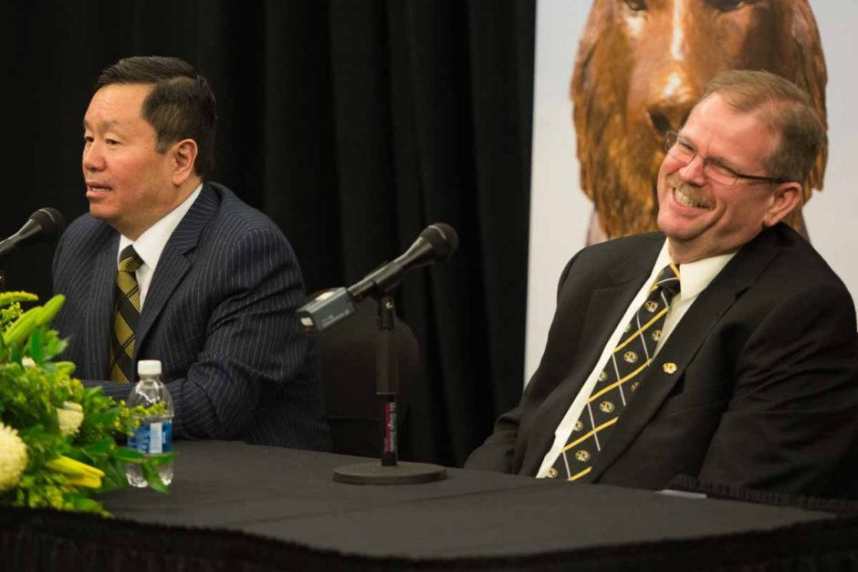 Chancellor Alex Cartwright and President Mun Choi share a laugh after Choi says they're so similar they could be twins.