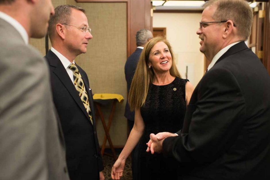 Cartwright meets Columbia's mayor, Brian Treece, and his wife Mary Phillips after the press conference ends.
