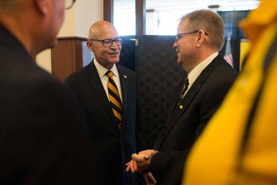 Chancellor Alex Cartwright speaks with former interim President Michael Middleton during the reception.