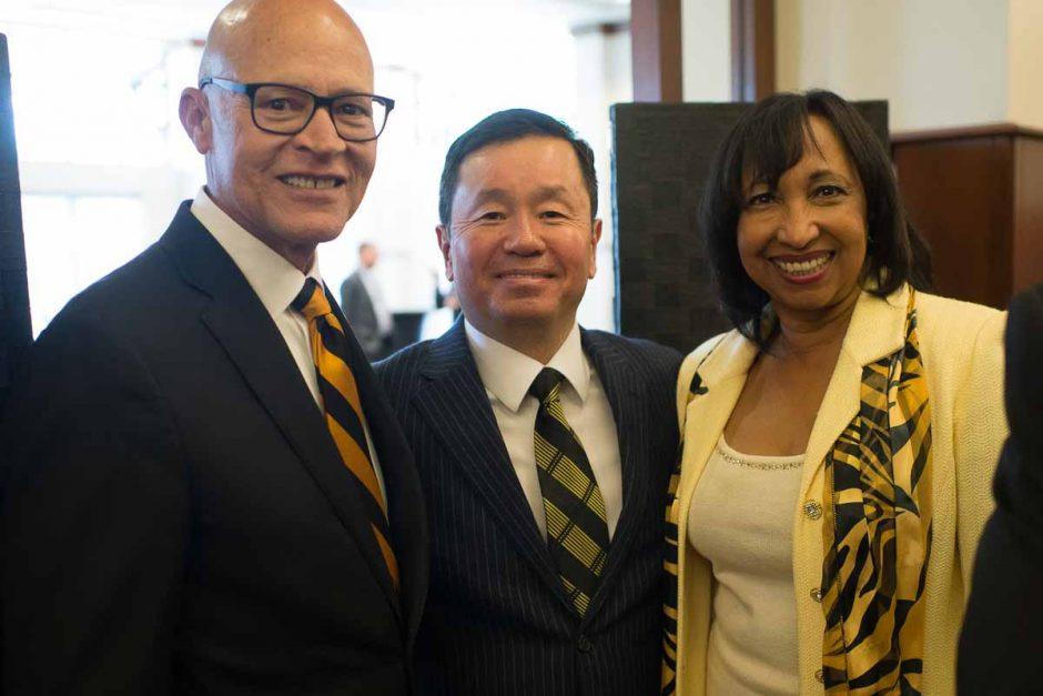 Former interim President Michael Middleton, President Mun Choi, and Julie Middleton pose for a portrait.