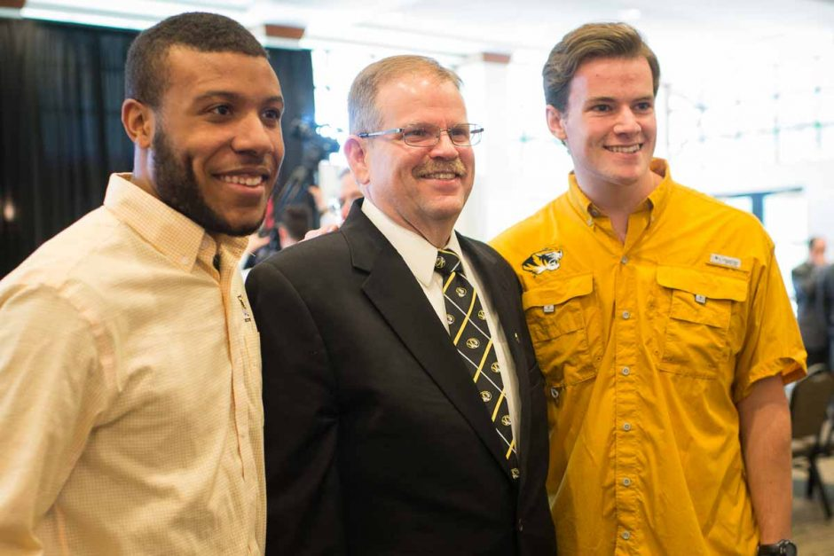 Chancellor Alex Cartwright stops for a photo request from students at the reception.
